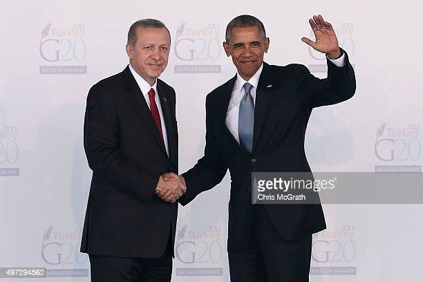 Turkish President Recep Tayyip Erdogan greets US President Barack Obama during the official welcome ceremony on day one of the G20 Turkey Leaders...