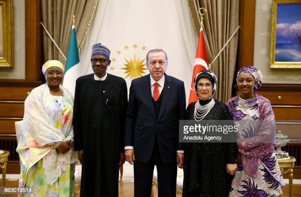 Turkish President Recep Tayyip Erdogan his spouse Emine Erdogan and Nigerian President Muhammadu Buhari and his spouse Aisha Buhari pose for a family...