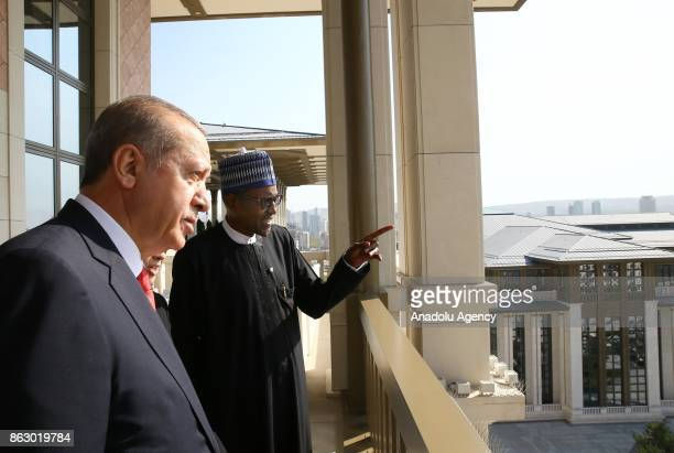 Turkish President Recep Tayyip Erdogan his spouse Emine Erdogan and Nigerian President Muhammadu Buhari and his spouse Aisha Buhari talk together at...
