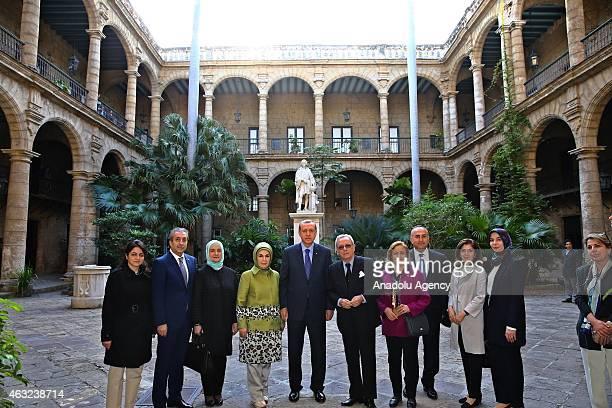 Turkish President Recep Tayyip Erdogan his wife Emine Erdogan and Turkish Foreign Minister Mevlut Cavusoglu pose in front of Havana museum during his...