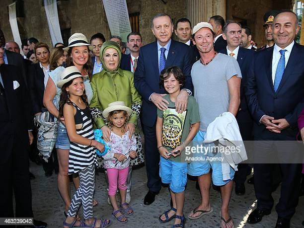 Turkish President Recep Tayyip Erdogan his wife Emine Erdogan and Turkish Foreign Minister Mevlut Cavusoglu pose with Turkish people during his...