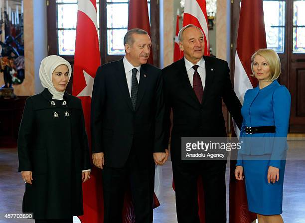 Turkish President Recep Tayyip Erdogan his wife Emine Erdogan Latvian President Andris Berzins and his wife Dace Seisuma pose ahead of a meeting at...
