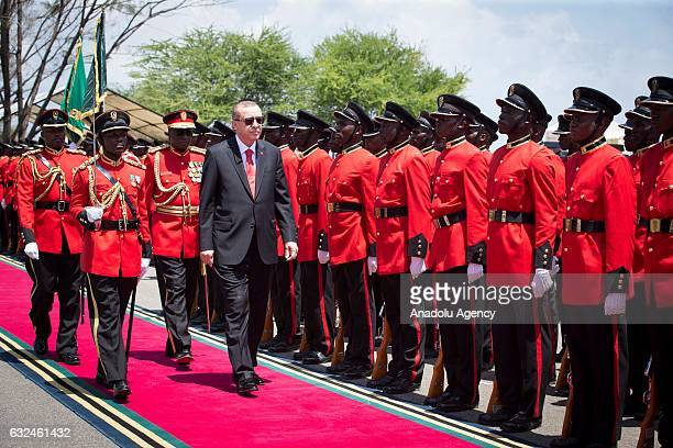 Turkish President Recep Tayyip Erdogan inspects a guard of honor during an official welcoming ceremony in Dar Es Salaam Tanzania on January 23 2017