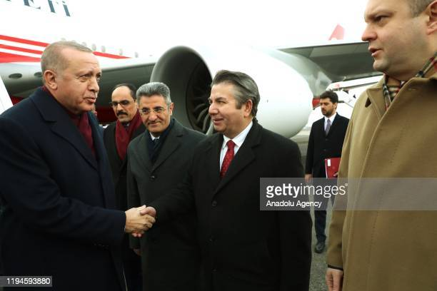 Turkish President Recep Tayyip Erdogan is being welcomed by an official Turkey's ambassador to Berlin Ali Kemal Aydin Turkey's Consul General in...