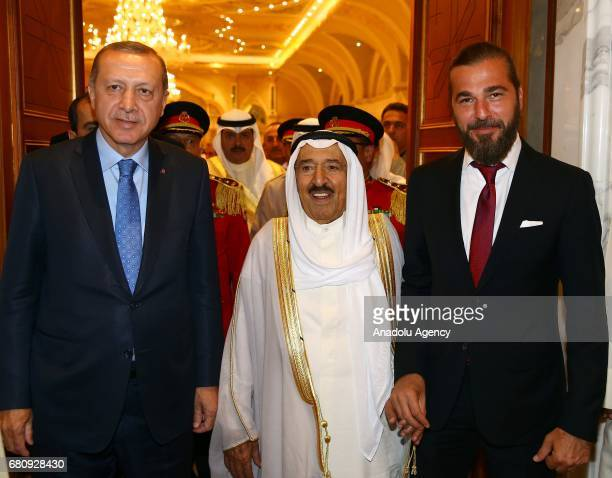 Turkish President Recep Tayyip Erdogan is bidden farewell by Kuwaiti Emir Sheikh Jaber alAhmad alSabah and Turkish actor Engin Altan Duzyatan at...