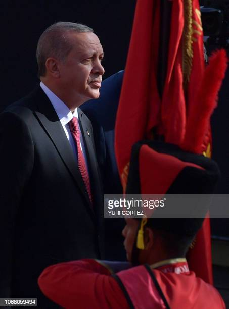 Turkish President Recep Tayyip Erdogan is pictured at Miraflores Presidential Palace in Caracas where he will hold a meeting with Venezuelan...