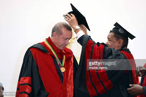 Turkish President Recep Tayyip Erdogan is presented with the title of honorary doctorate by Ethiopian President Mulatu Teshome Wirtu at Addis Ababa...