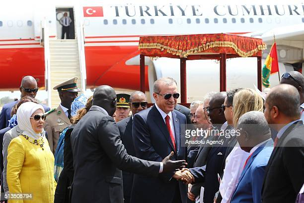 Turkish President Recep Tayyip Erdogan is welcomed by Guinea's President Alpha Conde with an official ceremony at the Conakry International Airport...