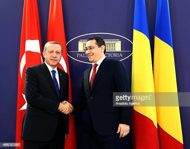 Turkish President Recep Tayyip Erdogan is welcomed by Romanian Prime Minister Victor Ponta prior to a meeting in Bucharest Romania on April 01 2015