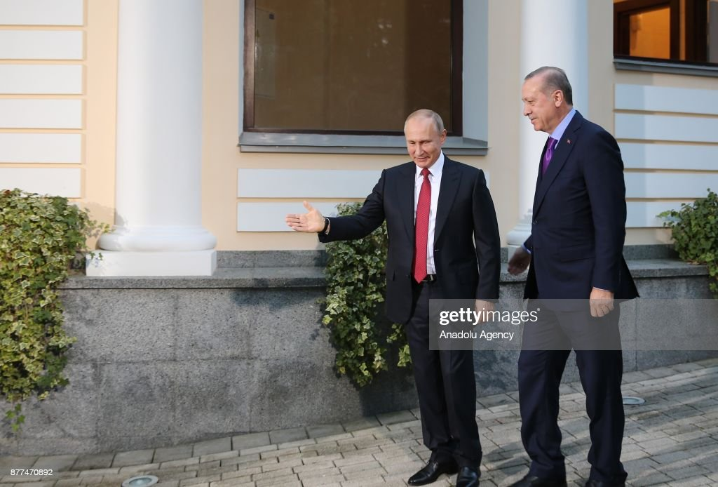 Turkish President Recep Tayyip Erdogan (R) is welcomed by Russian President Vladimir Putin (L) ahead of the trilateral summit to discuss progress on Syria, between the Presidents of Turkey, Russia and Iran on November 22, 2017 in Sochi, Russia.