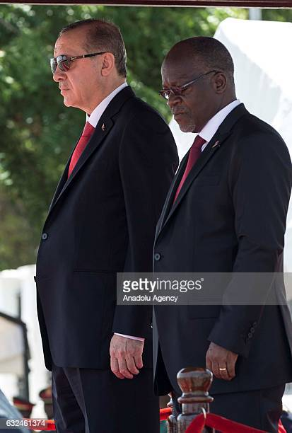 Turkish President Recep Tayyip Erdogan is welcomed by Tanzanian President John Magufuli during an official welcoming ceremony in Dar Es Salaam...