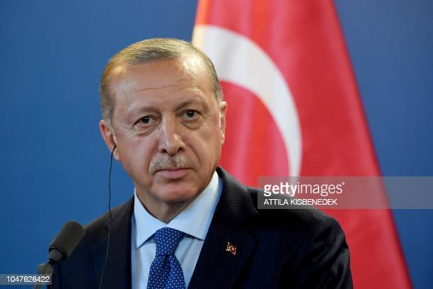 Turkish President Recep Tayyip Erdogan listens to a journalist's question during a joint press conference with the Hungarian Prime Minister after...