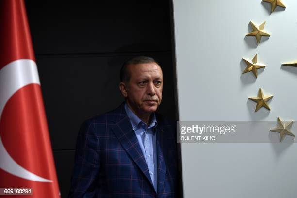 Turkish president Recep Tayyip Erdogan looks on as he arrives to deliver a speech at the conservative Justice and Development Party headquarters in...