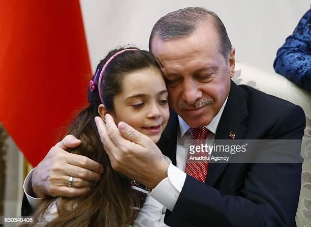 Turkish President Recep Tayyip Erdogan meets Syrian Bana Alabed sevenyearold girl who tweeted on attacks from Aleppo at Presidential Complex in...