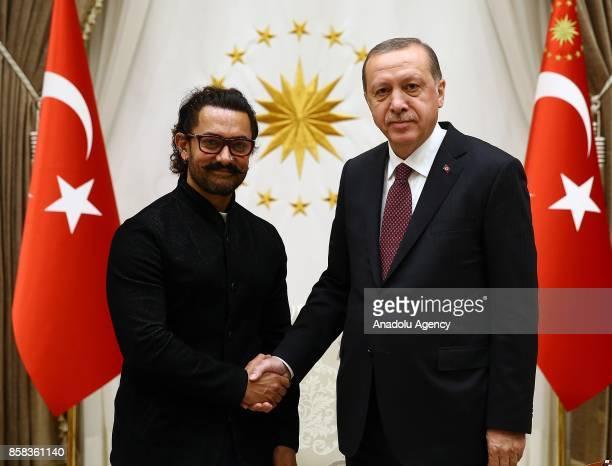 Turkish President Recep Tayyip Erdogan meets with Indian actor movie director and producer Aamir Khan in Ankara Turkey on October 6 2017