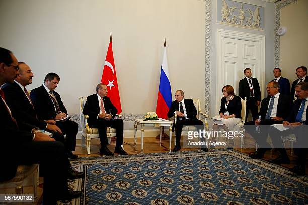 Turkish President Recep Tayyip Erdogan meets with Russian President Vladimir Putin in Saint Petersburg Russia on August 9 2016 Turkish Foreign...