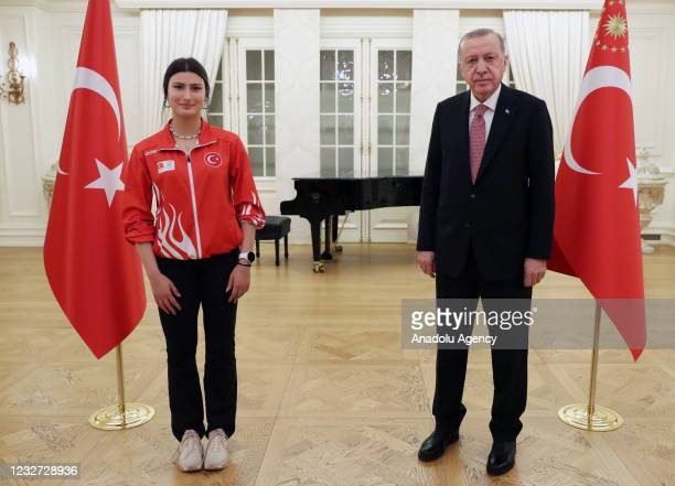 Turkish President, Recep Tayyip Erdogan poses for a photo with an athlete after an iftar dinner with medal winner athletes during holy Islamic...