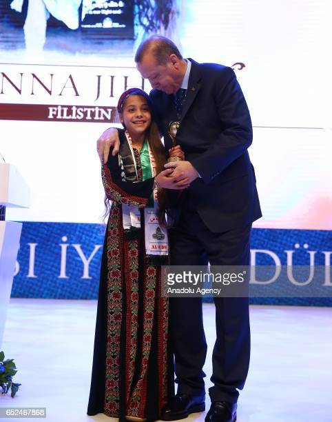 Turkish President Recep Tayyip Erdogan poses for a photo with Janna Jihad who reveals her country's problems via social media after giving an award...