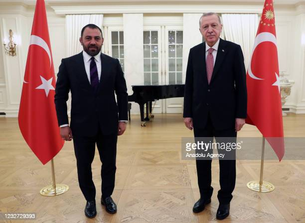 Turkish President Recep Tayyip Erdogan poses for a photo with Turkey's Deputy Minister of Youth and Sports, Hamza Yerlikaya during their iftar dinner...