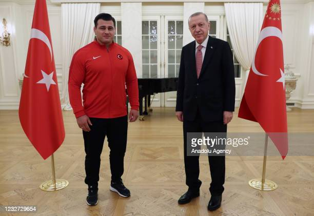 Turkish President Recep Tayyip Erdogan poses for a photo with Turkish wrestlers Riza Kayaalp during his iftar dinner with national athletes who won...
