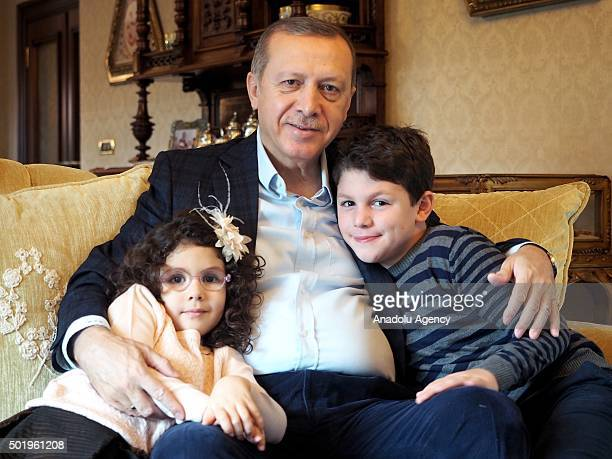 Turkish President Recep Tayyip Erdogan poses for famous Istanbulbased photojournalist Ara Guler with his grandson Ahmet Akif and granddaughter...