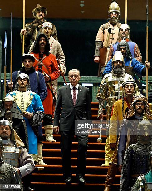 Turkish President Recep Tayyip Erdogan poses front of the 16 soldiers who represent the 16 Turkish states founded in the history during the visit of...