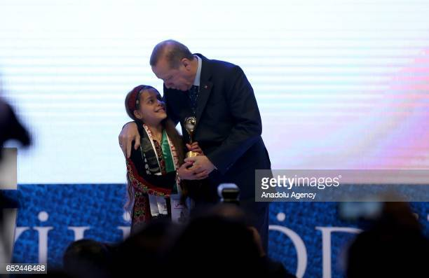 Turkish President Recep Tayyip Erdogan poses with Janna Jihad who reveals her country's problems via social media after giving an award titled brave...