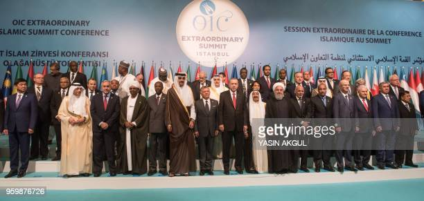 Turkish President Recep Tayyip Erdogan poses with other participants for a family photo session at the extraordinary summit of the Organisation of...