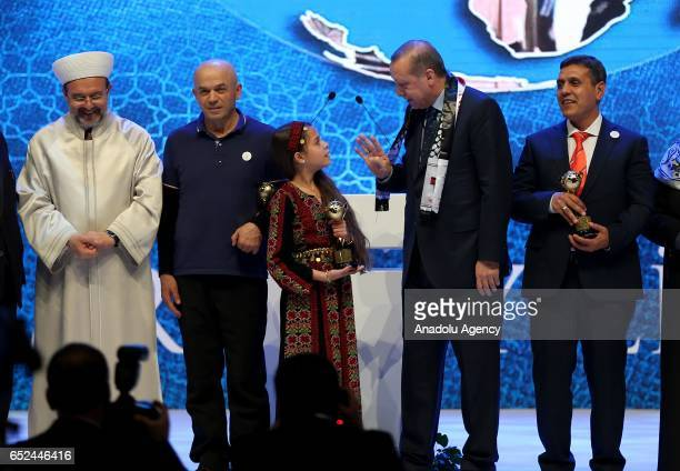 Turkish President Recep Tayyip Erdogan poses with President of the Directorate General for Religious Affairs Mehmet Gormez after giving an award...