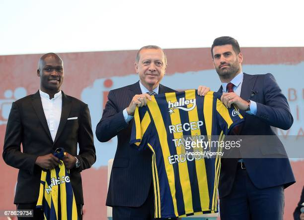 Turkish President Recep Tayyip Erdogan poses with soccer players Moussa Sow and Volkan Demirel of Fenerbahce during the Istanbul Youth Festival at...