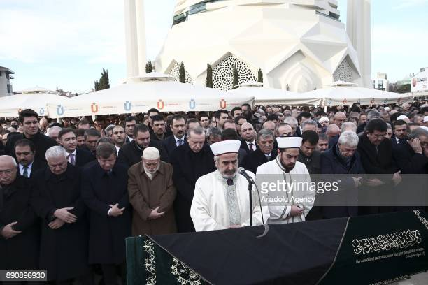 Turkish President Recep Tayyip Erdogan prays during a funeral ceremony of Turkish businessman President of the Executive Board of Istanbul Chamber of...