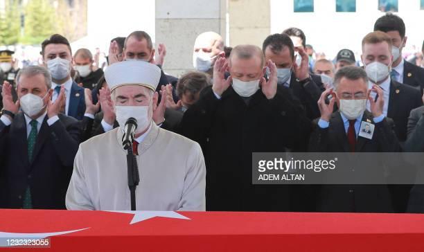 Turkish President Recep Tayyip Erdogan prays during the funeral of former Turkish Prime Minister Yildirim Akbulut, who passed away on April 14, at...