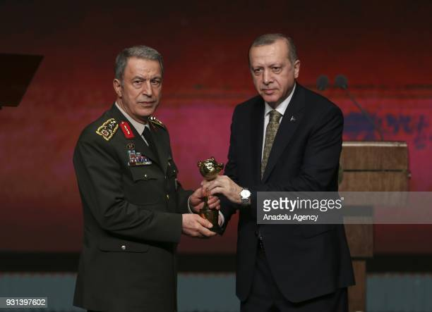 Turkish President Recep Tayyip Erdogan presents the Fidelity Award to Chief of General Staff of Turkish Armed Forces Gen Hulusi Akar during the...