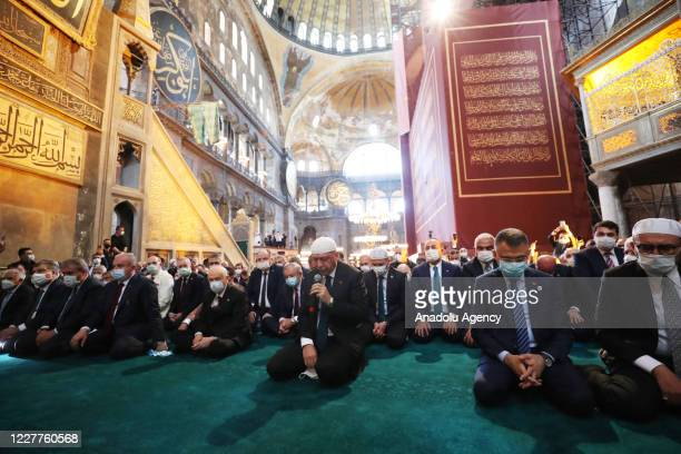 Turkish President Recep Tayyip Erdogan reads Qur'an at the Hagia Sophia Mosque which was opened to worship after 86 years ahead of the Friday Prayer...
