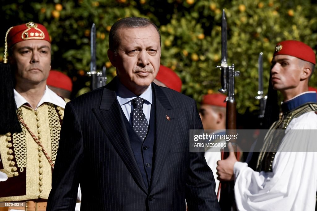 Turkish President Recep Tayyip Erdogan reviews the Greek Presidential Guard before a meeting in Athens, on December 7, 2017, as part of Erdogan's two-day official visit to Greece. /