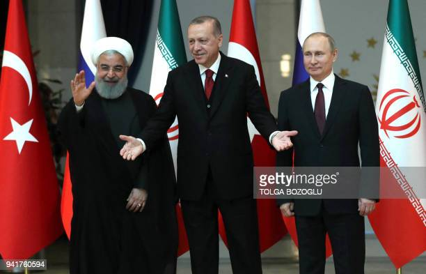 Turkish President Recep Tayyip Erdogan Russian President Vladimir Putin and President of Iran Hassan Rouhani pose for a photo ahead of the...