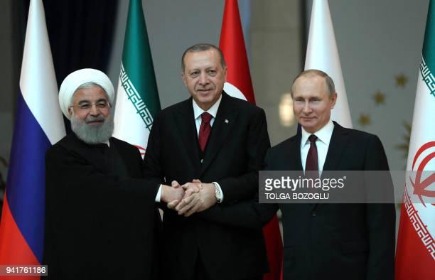 TOPSHOT Turkish President Recep Tayyip Erdogan Russian President Vladimir Putin and President of Iran Hassan Rouhani pose for a photo ahead of the...