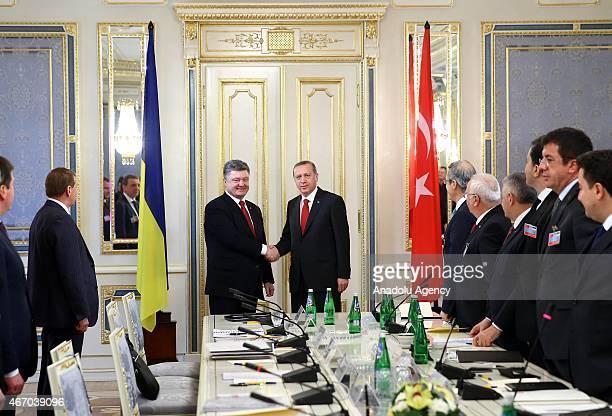 Turkish President Recep Tayyip Erdogan shake hands with with Ukrainian President Petro Poroshenko during their meeting in Kiev Ukraine on March 20...