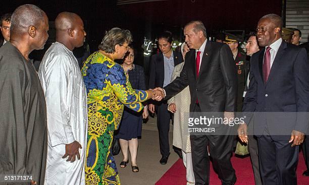 Turkish President Recep Tayyip Erdogan shakes hand with Ghana's Minister of Foreign Affairs Hanna Tetteh as Ghana's Vice President Kwesi Bekoe...