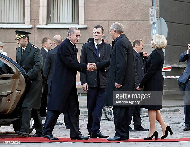 Turkish President Recep Tayyip Erdogan shakes hand with Latvia's President Andris Berzins after arriving at House of Blackheads in Riga Latvia on...