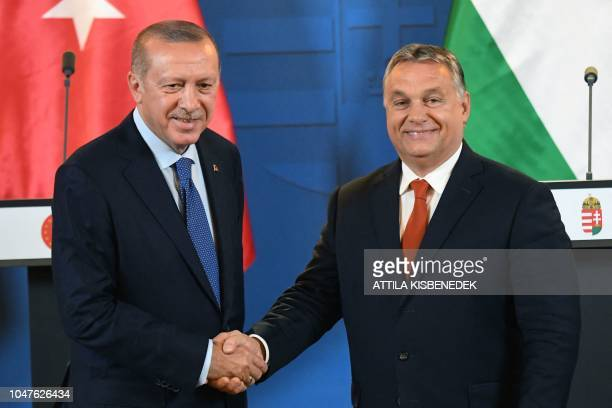 Turkish President Recep Tayyip Erdogan shakes hands with Hungarian Prime Minister Viktor Orban after their joint press conference following official...