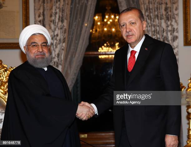Turkish President Recep Tayyip Erdogan shakes hands with Iranian President Hassan Rouhani ahead of their meeting at the historical Mabeyn Palace in...