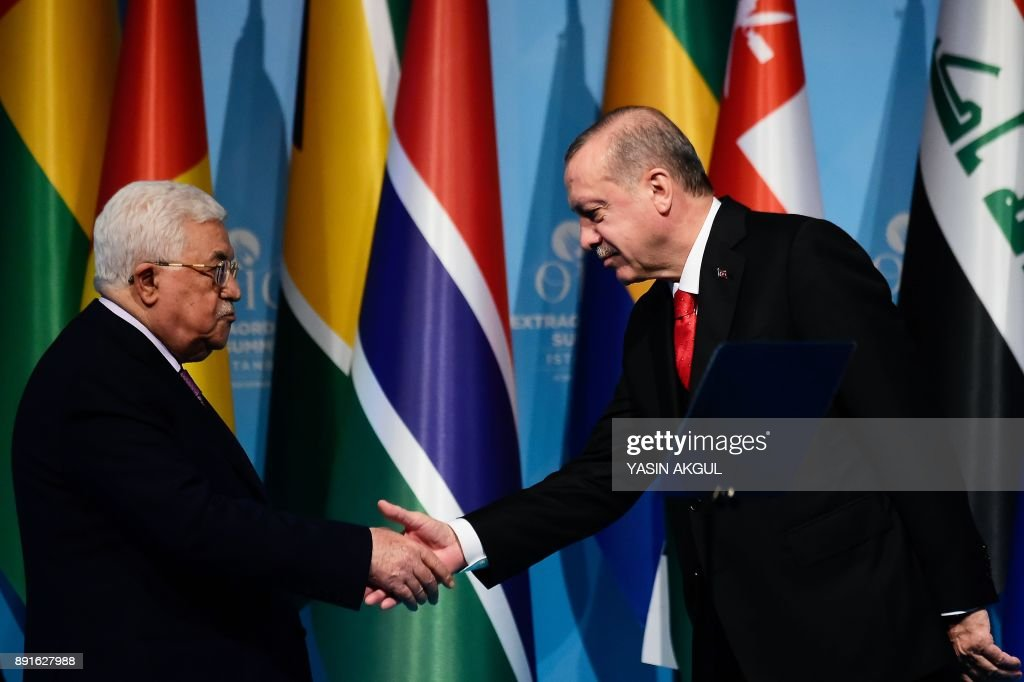 TOPSHOT - Turkish President Recep Tayyip Erdogan (R) shakes hands with Palestinian President Mahmoud Abbas (L) after a press conference following the Extraordinary Summit of the Organisation of Islamic Cooperation (OIC) on last week's US recognition of Jerusalem as Israel's capital, on December 13, 2017, in Istanbul. Islamic leaders on December 13 urged the world to recognise occupied East Jerusalem as the capital of Palestine, as Palestinian president Mahmoud Abbas warned the United States no longer had any role to play in the peace process. /
