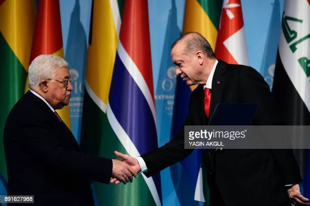 TOPSHOT Turkish President Recep Tayyip Erdogan shakes hands with Palestinian President Mahmoud Abbas after a press conference following the...