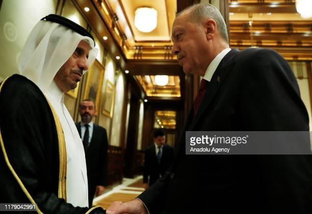 Turkish President Recep Tayyip Erdogan shakes hands with Qatari Prime Minister Sheikh Abdullah bin Nasser bin Khalifa Al Thani following their...