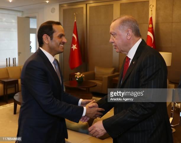 Turkish President Recep Tayyip Erdogan shakes hands with Qatars Vice President and Foreign Minister Sheik Mohammed bin Abdulrahman bin Jassim AlThani...