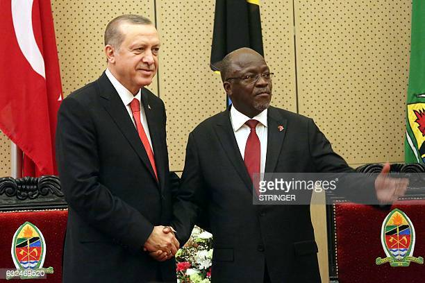 Turkish President Recep Tayyip Erdogan shakes hands with Tanzania's President John Pombe Joseph Magufuli following their joint press conference at...
