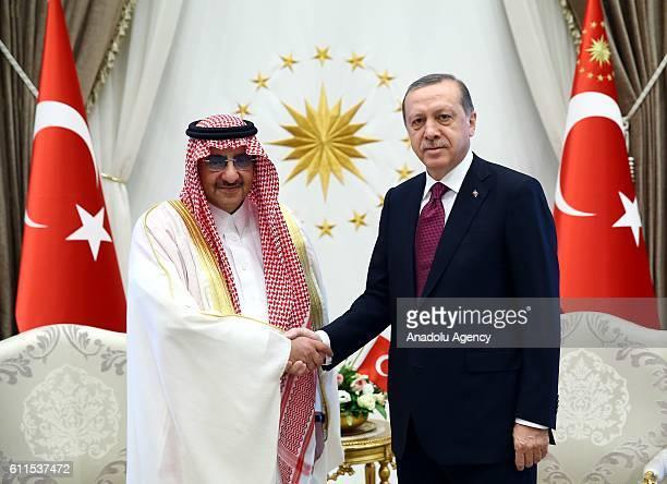 Turkish President Recep Tayyip Erdogan shakes hands with the Crown Prince of Saudi Arabia Muhammad bin Nayef bin Abdulaziz Al Saud during an official...