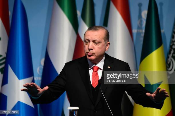Turkish President Recep Tayyip Erdogan speaks as he holds a press conference following the Extraordinary Summit of the Organisation of Islamic...