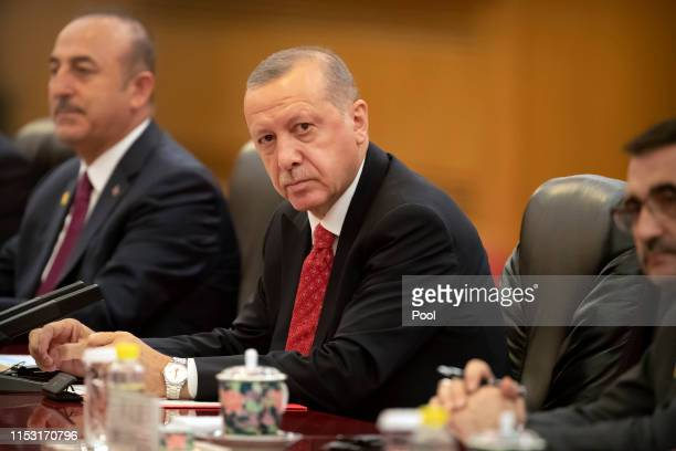 Turkish President Recep Tayyip Erdogan speaks during a meeting with Chinese President Xi Jinping at the Great Hall of the People on July 2, 2019 in...